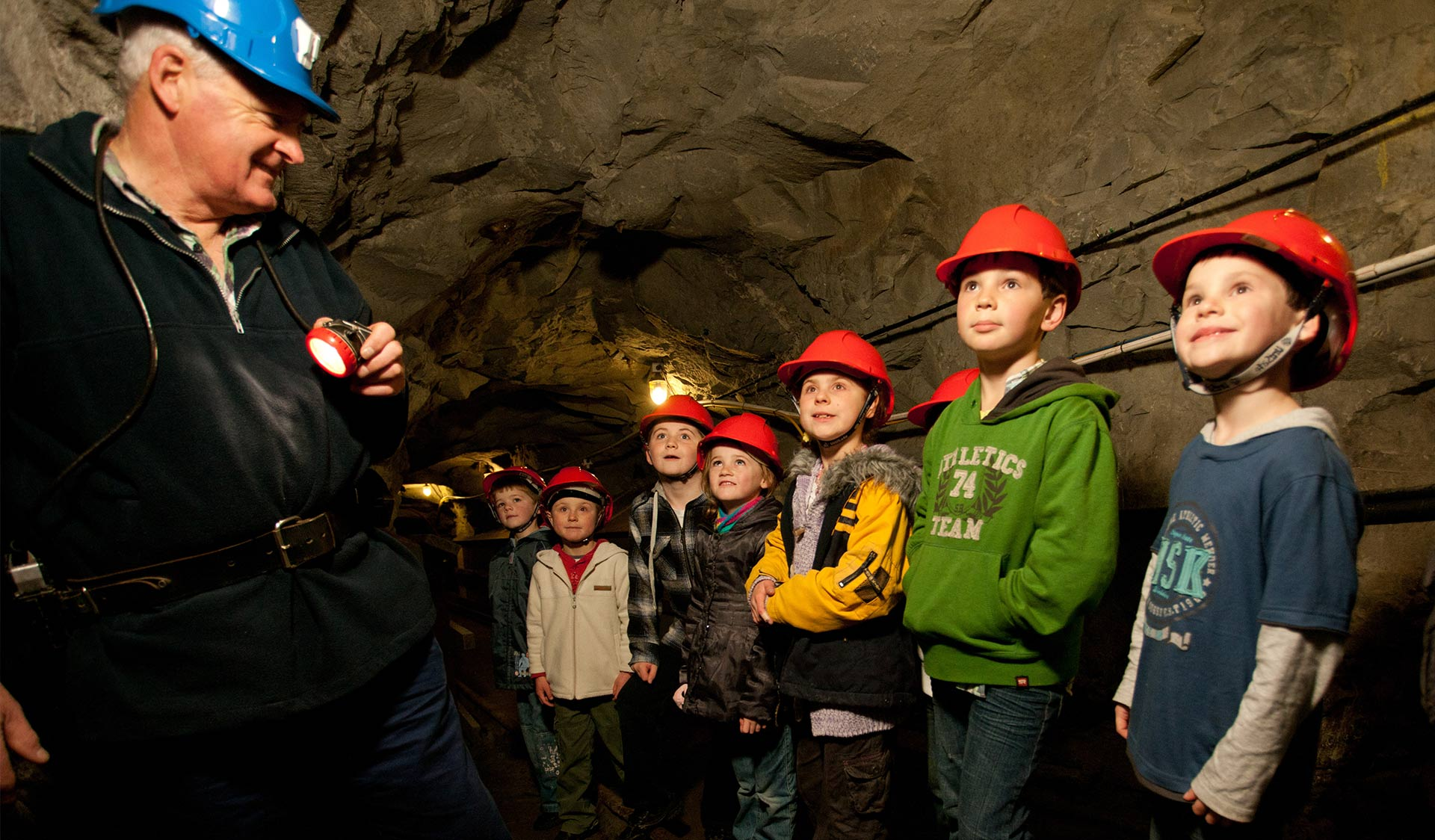 A group of children on a tour in the State Coal Mine.