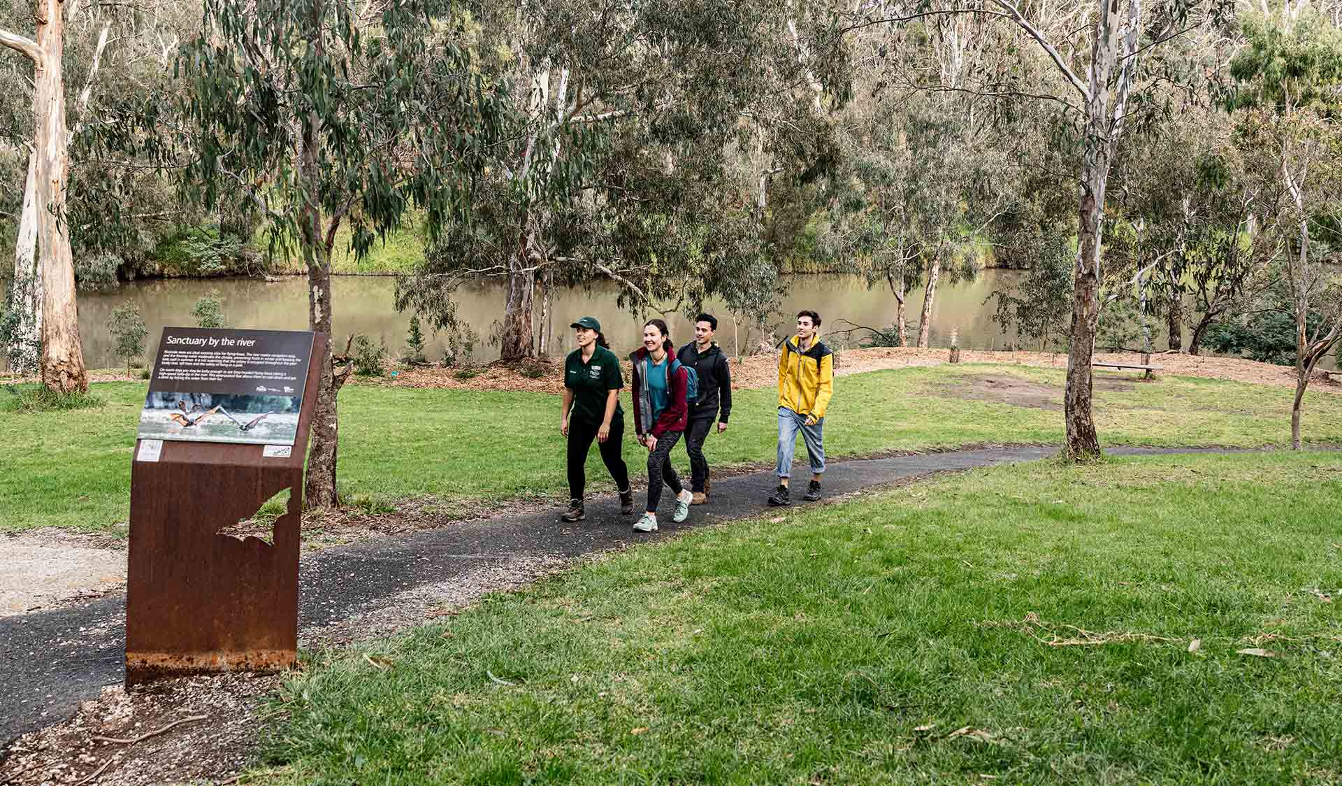 A group take a volunteer led tour through the Flying Fox environments on the banks of the Yarra River in Yarra Bend Park