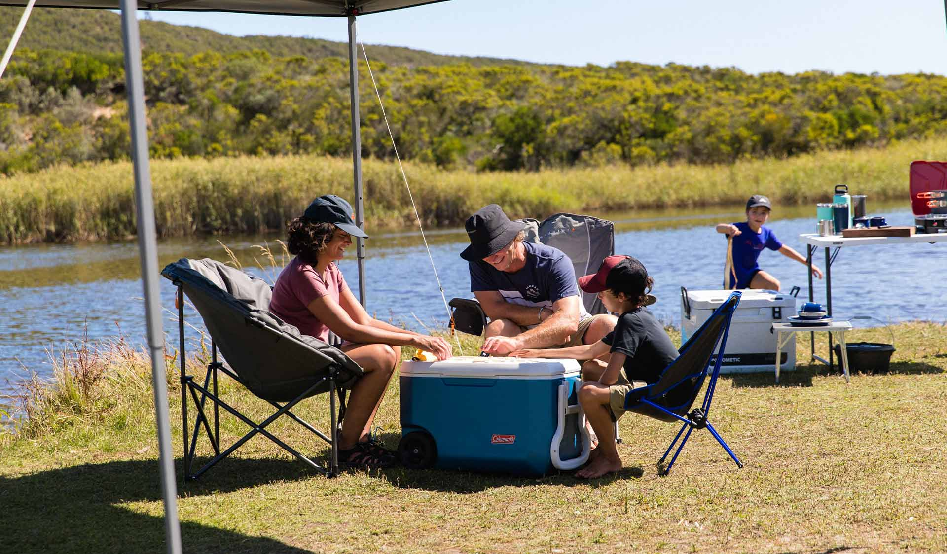 A family camps on the shores of Aire River in the Great Otway National Park