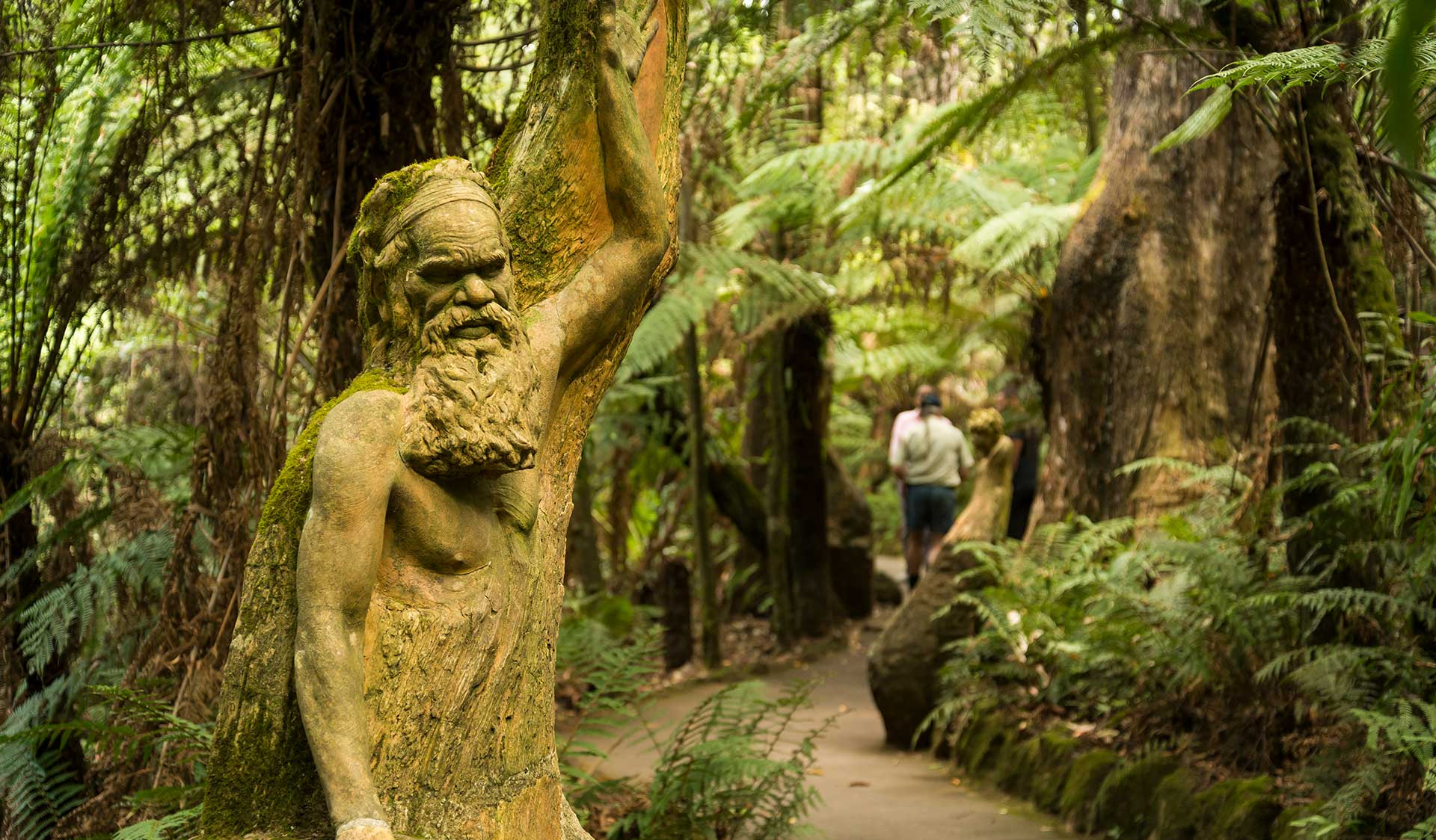 A sculpture looks over a walking path in the William Ricketts Sanctuary.