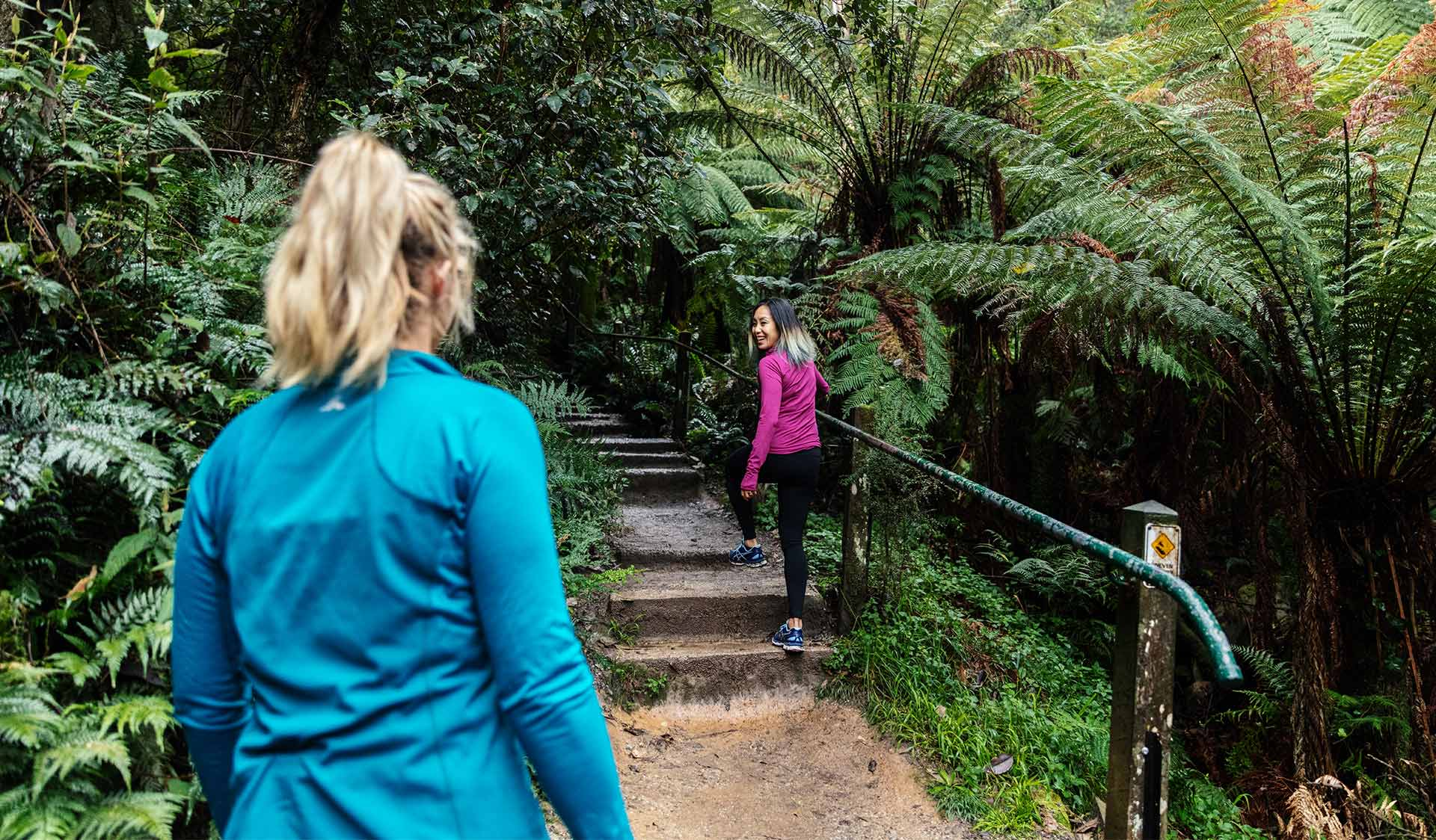 Two women walk up the 1000 steps track.