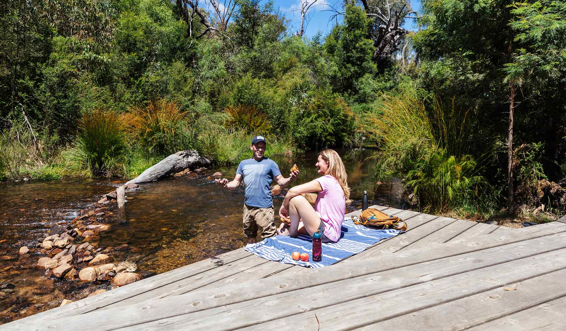 A couple enjoy a picnic by the MacKenzie river at Zumsteins Historic Area.