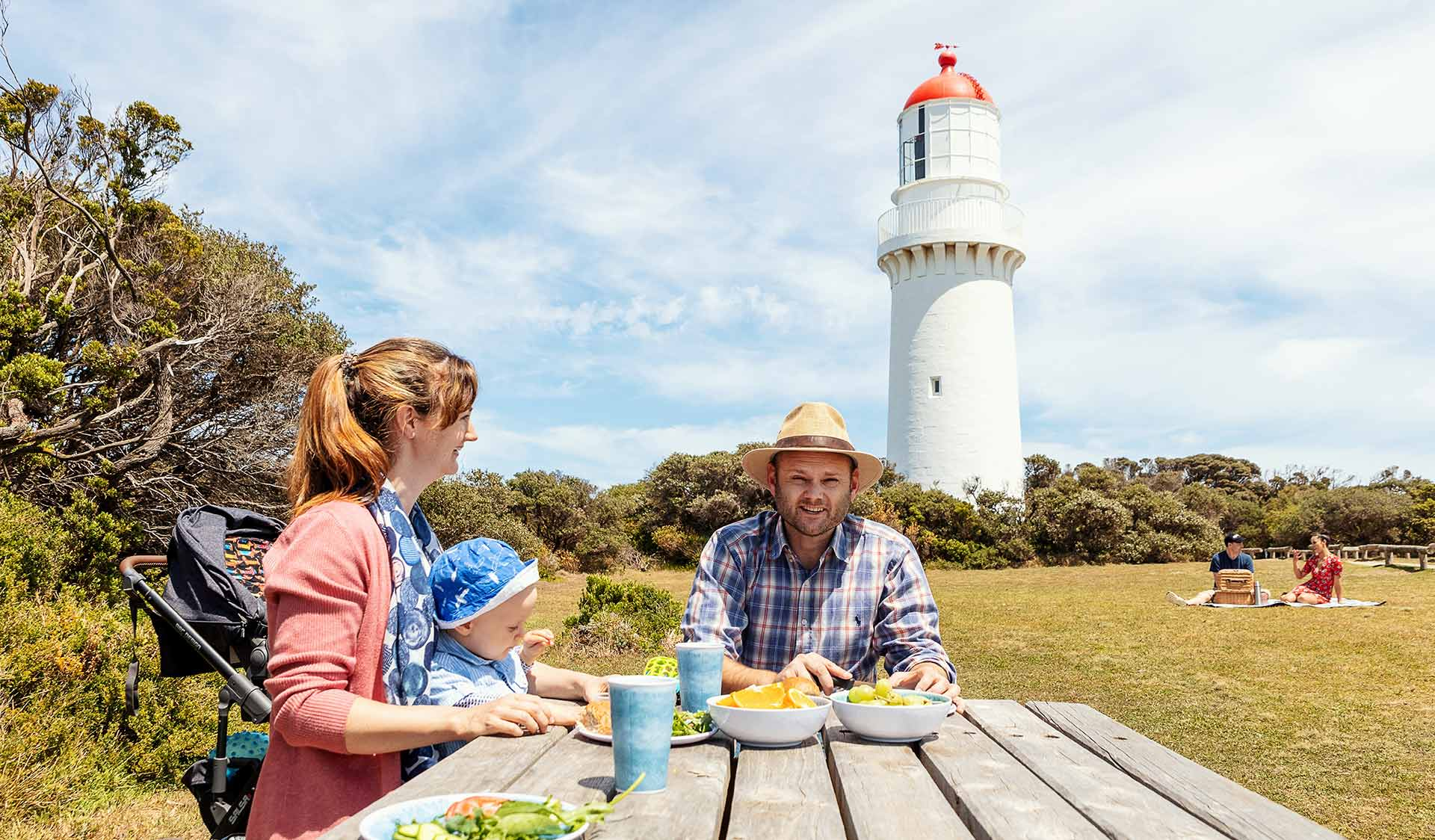 A young family eating at a picnic table at the Cape Schanck Lighthouse