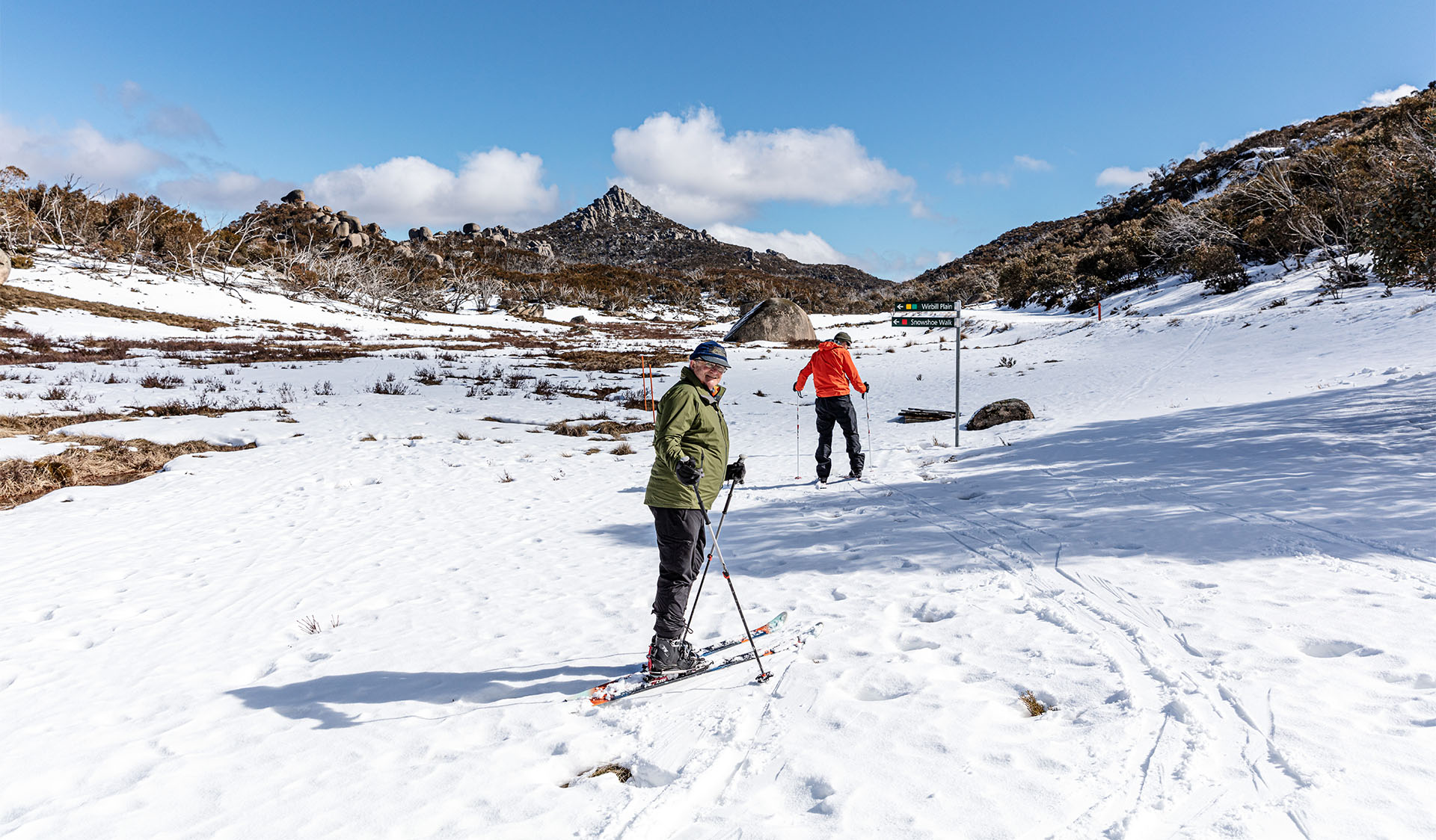 Two people cross country skiing at Cresta Valley in Mount Buffalo National Park.