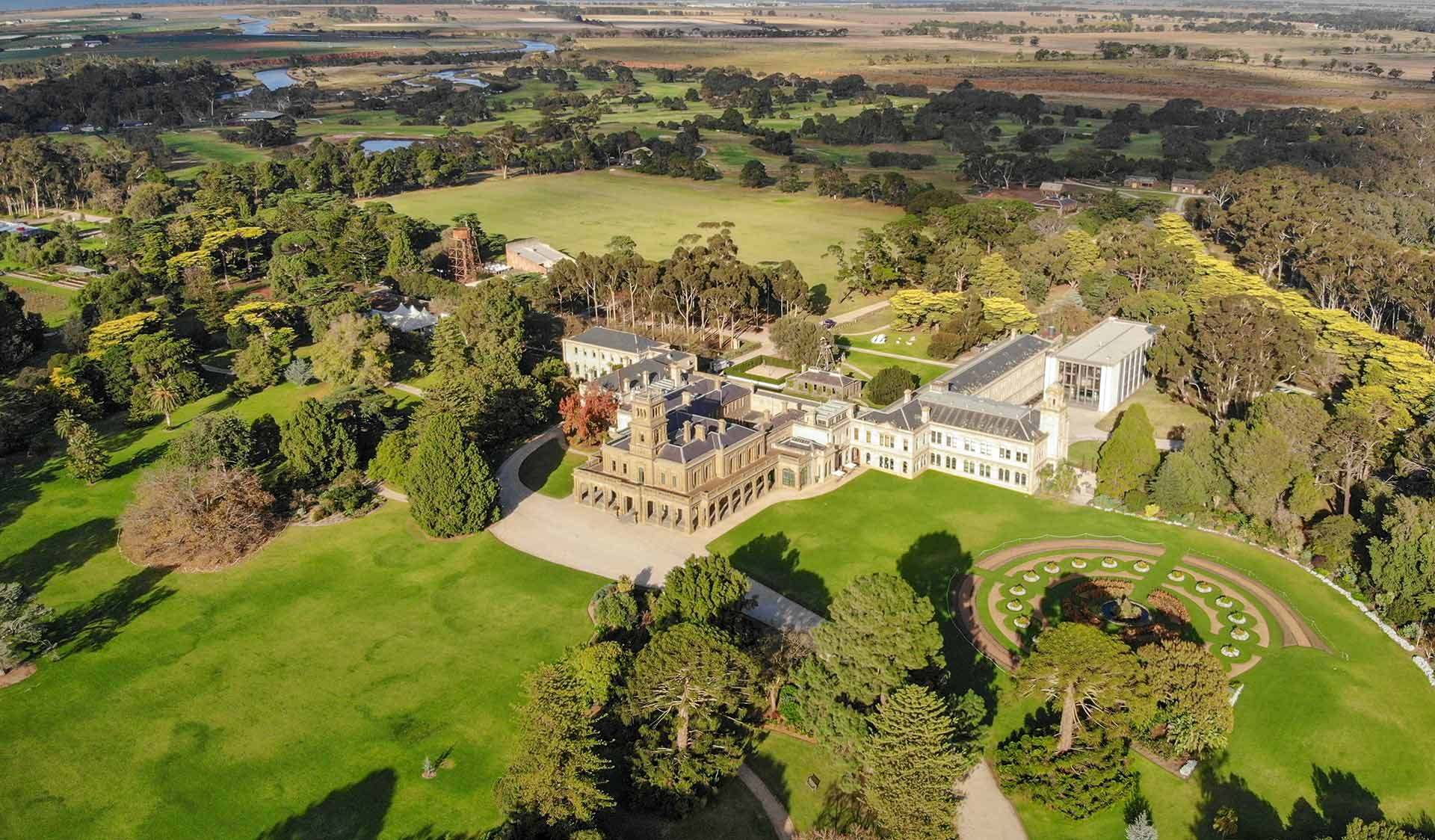 An aerial view of Werribee Mansion and its surrounding gardens.