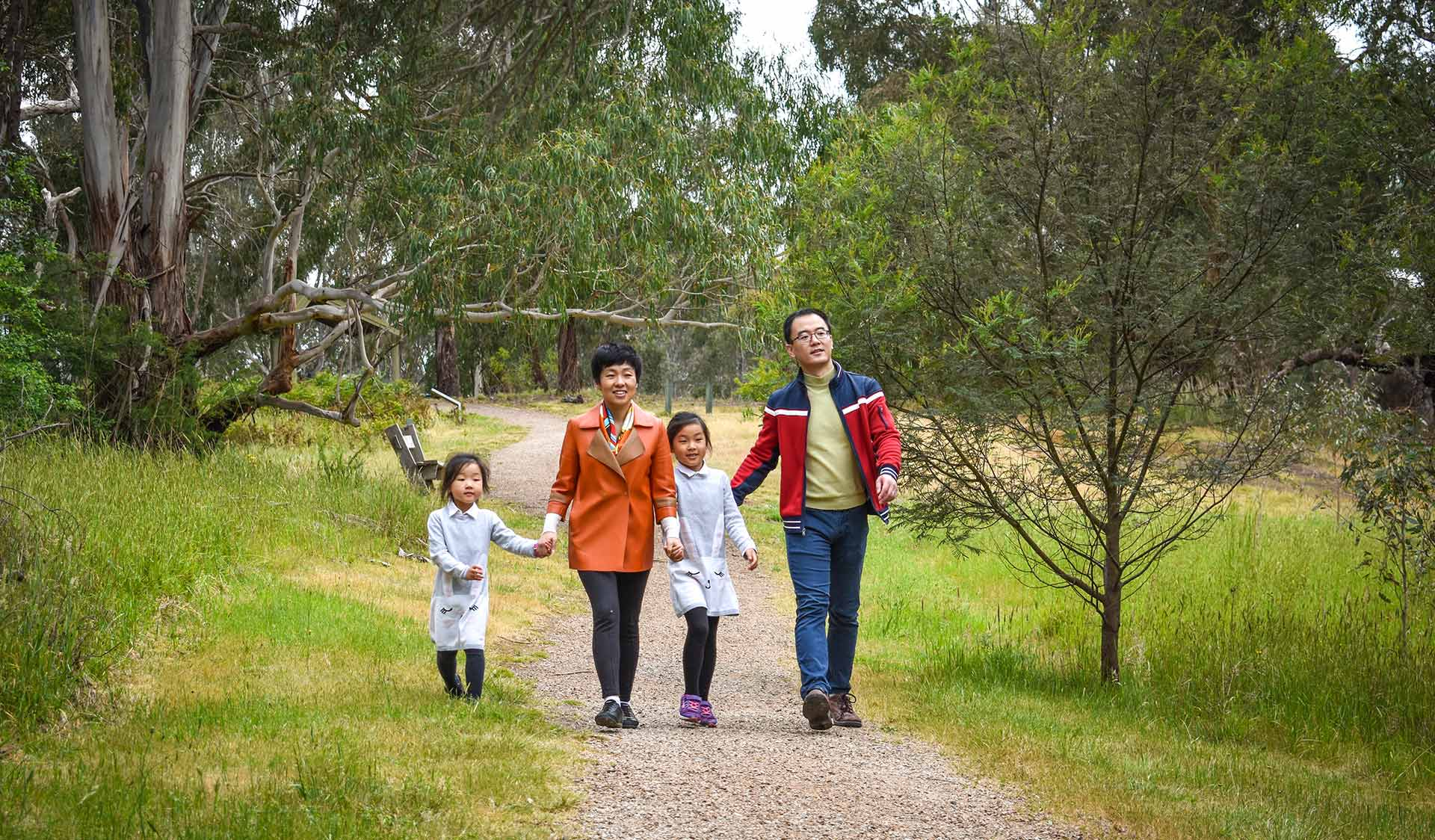 A family walk along a sealed path in Westerfolds Park.