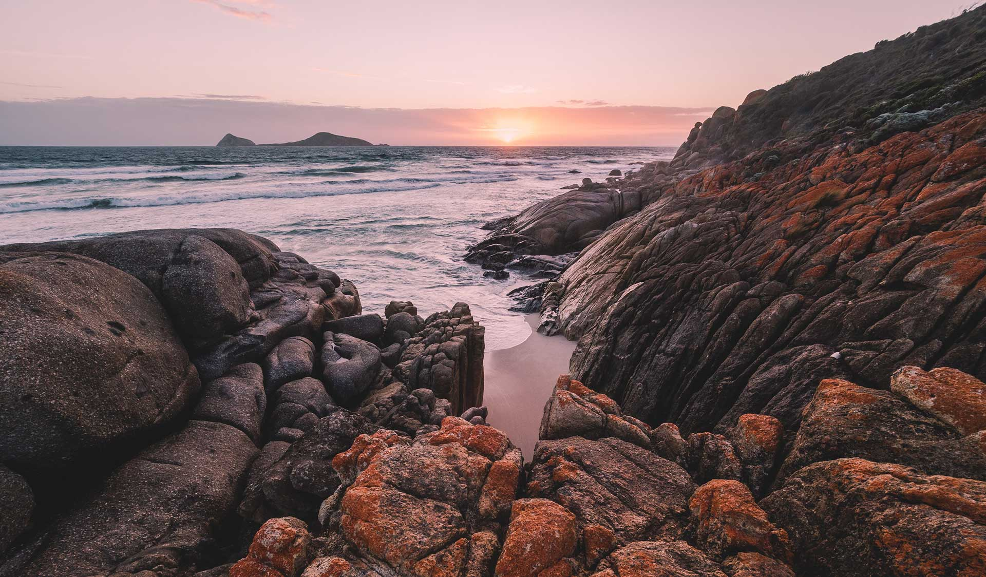 Sunset on the rocks at Whiskey Bay in Wilsons Promontory National Park.