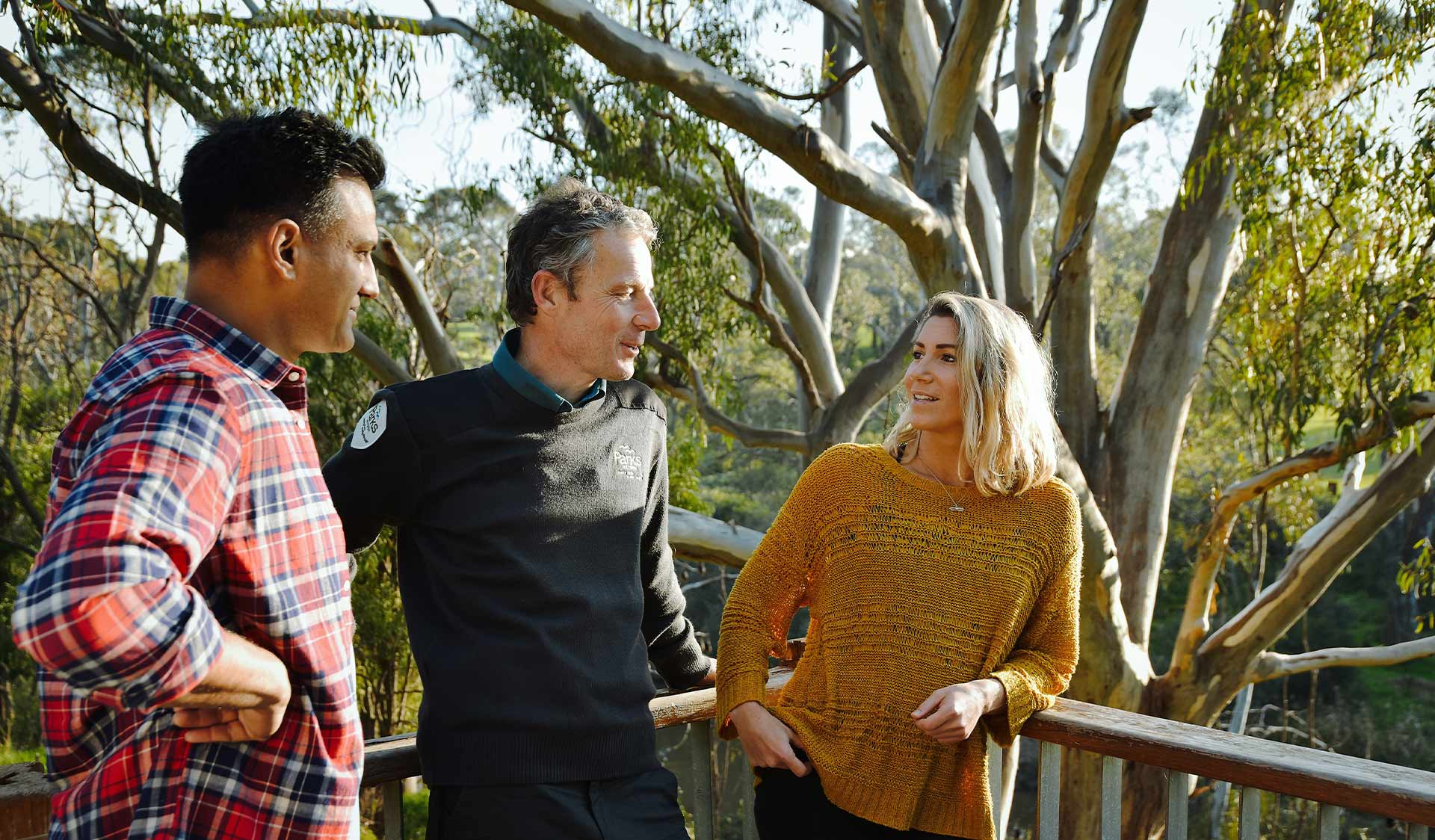 A ranger chats with two park goers in Yarra Bend Park.