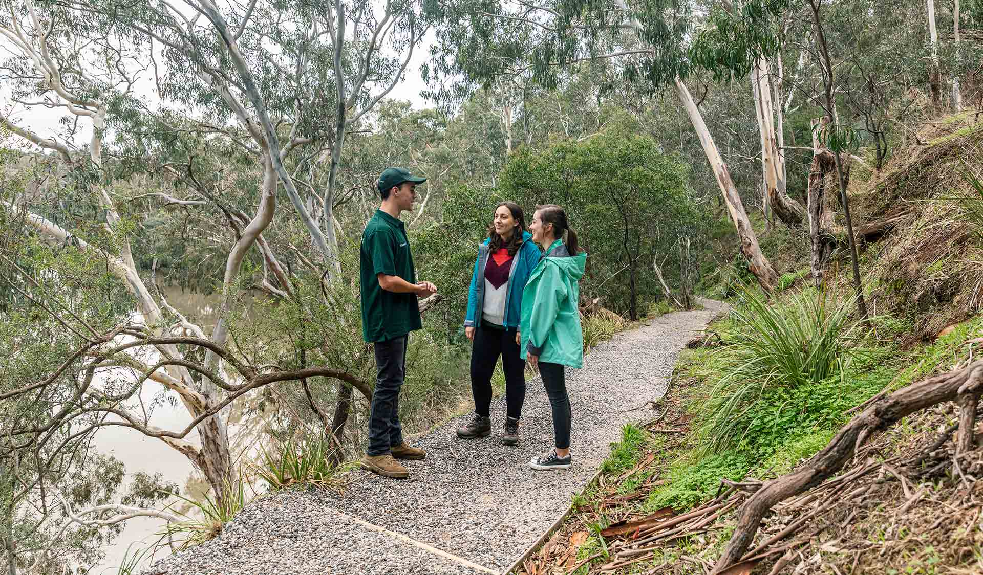 Two women take a volunteer led tour through the Flying Fox environments on the banks of the Yarra River in Yarra Bend Park