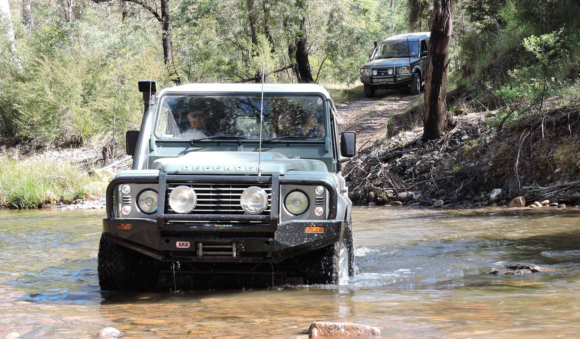 A Land Rover Defender attempts a river crossing in the Alpine National Park.